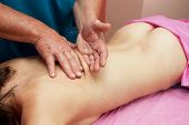 stock photo of low-necked  - Woman having a massage at spa - JPG