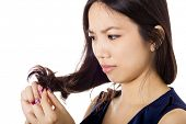 Asian woman with hair problem