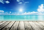 stock photo of sunny beach  - Caribbean sea and wooden platform - JPG