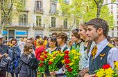 BARCELONA, SPAIN - SEPTEMBER 11: Unidentified Catalan youth offers flowers  to the monument of Rafael Casanova during the National Day of Catalonia, Barcelona, Spain on September 11, 2013