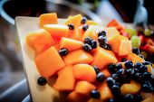 foto of fruit platter  - Beautiful mixed fruit platter with canteloupes and blueberries - JPG