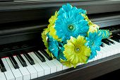 Green And Blue Bouquet On Piano