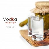 Russian vodka with traditional black bread and pickles on white background (with easy removable samp