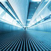 Moving walkway in modern building.