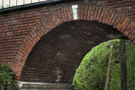 stock photo of cornerstone  - Arch of the foot bridge with a white cornerstone against pleasant - JPG