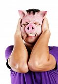 Stressed man with pig mask