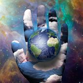Earth and hand before cosmos  Elements of this image furnished by NASA