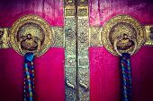 Vintage retro hipster style travel image of door handles on gates of Ki monastry. Spiti Valley, Hima