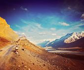 Vintage retro hipster style travel image of  road to Kee (Ki, Key) Monastery. Spiti Valley,  Himacha