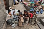 SANAA, YEMEN - MARCH 22, 2012: Children playing with toy guns on the street of Sanaa