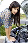 Sad Woman In Front Of Broken Car