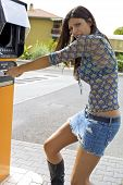 pic of automatic teller machine  - Beautiful female model fighting with atm machine - JPG