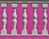 picture of balustrade  - Close up of white Precast Balustrades with pink house wall - JPG