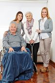 Family with three generations and senior couple at home