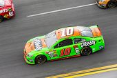 Daytona Beach, NC - Feb 23, 2014:  Danica Patrick (10) brings her race car through the turns during