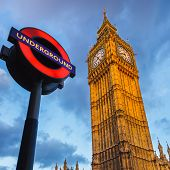 LONDON - MAY 08 2009:  The London 'Underground' sign and 'Big Ben' tower at evening on May 08 2009 i