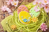 Colorful easter cookies in a nest
