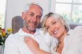 Close-up portrait of a happy mature couple relaxing on sofa at home