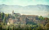View of the Alhambra from the Albayzin of Granada, Andalusia, Spain. Photo in retro style. Added pap