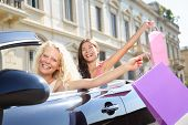 Car driver woman driving and shopping with girl friends holding shopping bags happy and excited on r