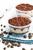 dessert tiramisu and coffee beans on kitchen table