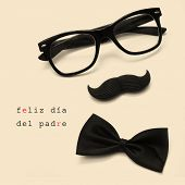 sentence feliz dia del padre, happy fathers day written in spanish, and glasses, mustache and bow tie forming a man face in a beige background