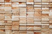 stock photo of 2x4  - Stack of square wood planks for furniture materials - JPG