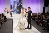 ZAGREB, CROATIA - FEBRUARY 15, 2014: Fashion models dressed as bride and groom on 'Wedding fair'