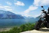 lake Garda in Italy. Motorbike standing on shore