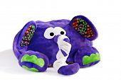 Colorful stuffed elephant with trunk wrapped in bandages on white background.  Ideal as get well car