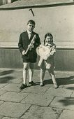 LODZ, POLAND, SEVENTIES - Vintage photo of little boy with his sister at his First Communion