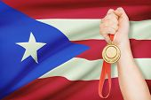 Medal In Hand With Flag On Background - Commonwealth Of Puerto Rico