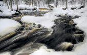 flowing winter waters at Nommeveski waterfall, Estonia