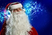 Santa Claus wearing headphones and enjoying music