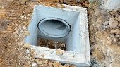 pic of waterspout  - the concrete drainage tank on construction site - JPG