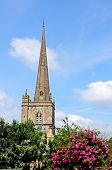 pic of church-of-england  - St John the Baptist church spire Burford Oxfordshire England UK Western Europe - JPG