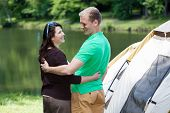 image of snuggle  - Portrait of happy snuggled couple on camping