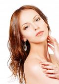 Beautiful young woman with fresh pure skin. Healthcare. Isolated over white.
