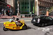 San Francisco, Usa - Oct 2, 2011: Tourists Make Gps-guided Tour On Special Equipped Three-wheel Stor