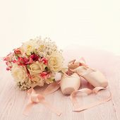 Bridal bouquet of white flowers on wooden surface.
