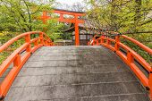 Japanese architecture, Orange arched bridge and Torii in shimogamo-jinja, Kyoto, Japan