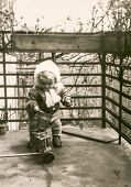 Vintage photo of little girl playing on balcony (fifties)