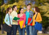 friendship, vacation, education and people concept - group of smiling teenagers with folders and sch