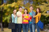 friendship, vacation, education, gesture and people concept - group of smiling teenagers with folder