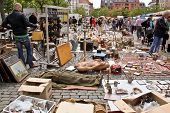 Brussels, Belgium - May 22 - People Choose Things On A Flea Market On May 22, 2011 In Brussels