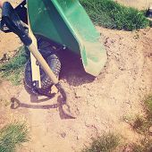 Wheelbarrow and spade with instagram effect