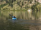stock photo of cottonwood  - Kayaking on Cottonwood lake in the valley on clear calm day with the lake stretching off to distance - JPG