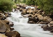 Blurred Motion Of Mountain River