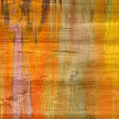 art abstract colorful silk textured blurred background in gold, orange and beige colors