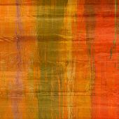 art abstract colorful silk textured blurred background in orange, gold and green colors